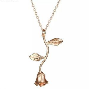 Rose gold rose bud dangle necklace.